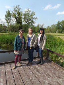 Molly with Charlotte Hitchmough, Director of Action for the River Kennet and Anna Forbes, Project Officer, standing on the raised boardwalk above the recently created wetland
