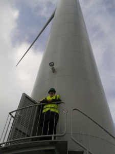 Molly by a wind turbine at Delabole